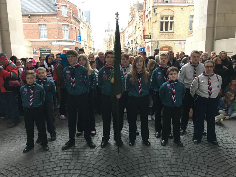 Scouts in uniform with flag